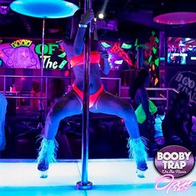 Exotic pole dancer wearing  orange bikini Miami Strip Club Booby Trap On The River